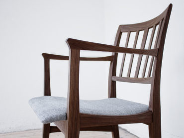 Handmade wooden chair Talavid made in walnut upholstered with a handwoven linen fabric